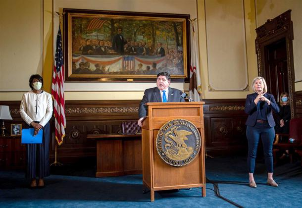 Gov. JB Pritzker and Dr. Ngozi Ezike, director of the Illinois Department of Public Health, brief the media Friday on the state's COVID-19 pandemic during a news conference in the governor's office at the Capitol in Springfield. (Pool photo by Justin L. Fowler/State Journal-Register)