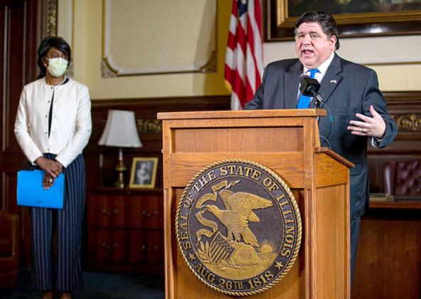 Gov. JB Pritzker and Dr. Ngozi Ezike. (Pool photo by Justin L. Fowler/State Journal-Register)