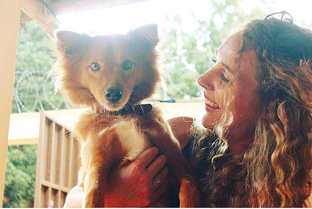 "Homeward bound — Beardstown's Audra Elam is pictured with her dog ""Socrates"" in a photo taken in Togo, where she served as a Peace Corps volunteer (Photo submitted.)"