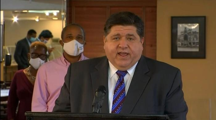 Gov. JB Pritzker speaks at a news conference in Chicago Tuesday. He announced the next round of Business Interruption Grants and warned of future state budget cuts without further federal government intervention. (Credit: Blueroomstream.com)