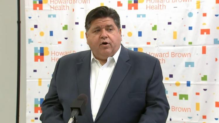 Gov. JB Pritzker announces the release of $140 million in federally-funded grants to Federally Qualified Health Centers, safety net hospitals and long-term care facilities during a news conference Friday at Howard Brown Health Center in Chicago. (Credit: blueroomstream.com)