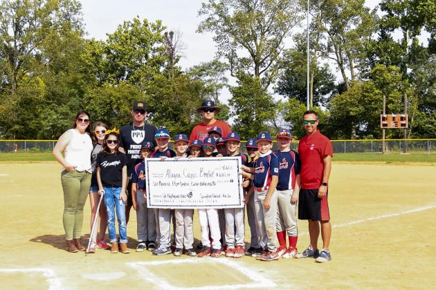An incredible act of kindness — The Capps family is pictured with the members of the Springfield Cardinals 10 and under boys baseball team that presented them with a check for $6,300, money the boys raised to donate toward Alayna Capps' medical expenses, a caring donation to a family they didn't know and a girl they'd never met. Submitted Photo