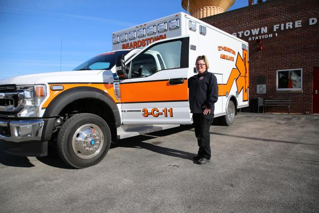 New wheels — Heather Clayton, an EMT with Beardstown Ambulance, is pictured with the department's new, 4-wheel drive ambulance that was delivered last week. (photo by Brian DeLoche)
